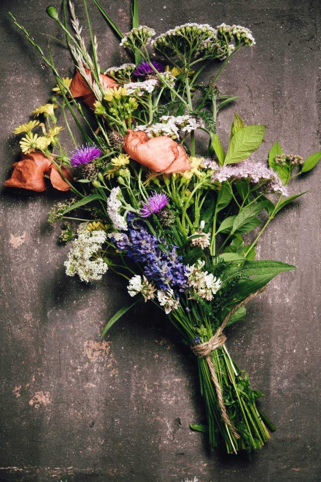 Wild flower bouquet on vintage background